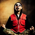 meditator in red vest and sunglasses